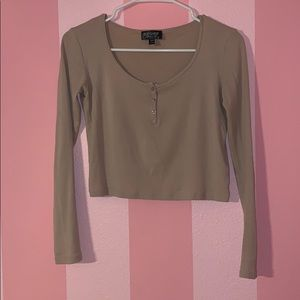 Pale pink long-sleeved cropped henley